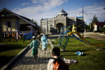 Children run to a newly built mosque in their neighborhood, in Banda Aceh, Indonesia, on Tuesday, Nov. 17, 2009. The neighborhood was devastated by the tsunami, killing most of the residents. Most of the homes here have been rebuilt by the Irish Red Cross. On Dec. 26, 2004, a 9.0 magnitude earthquake triggered a massive tsunami that killed 226,000 people throughout several countries. In Aceh, the death toll alone was 166,000.