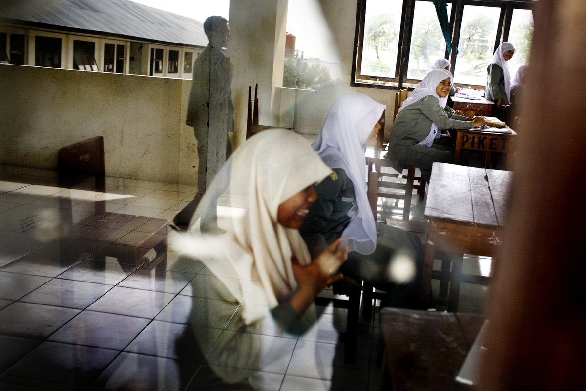Junior High and High School students study at the Islamic School, which offers both national and Islamic curriculum, in Banda Aceh, on Tuesday, Nov. 10, 2009. Although Aceh is a matriarchal culture, women who break Sharia rules are often stigmatized, and often become objects of harassment, especially rape. Young adults who admit to having premarital sex are forced into marriage.