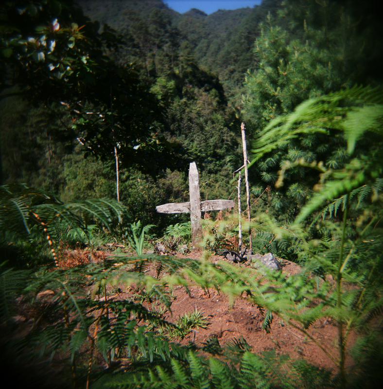 A wooden cross marks the grave of a victim who was killed by the military during the civil war, in a village outside of Uspantan, deep in the highlands of Guatemala, March 28, 2012.