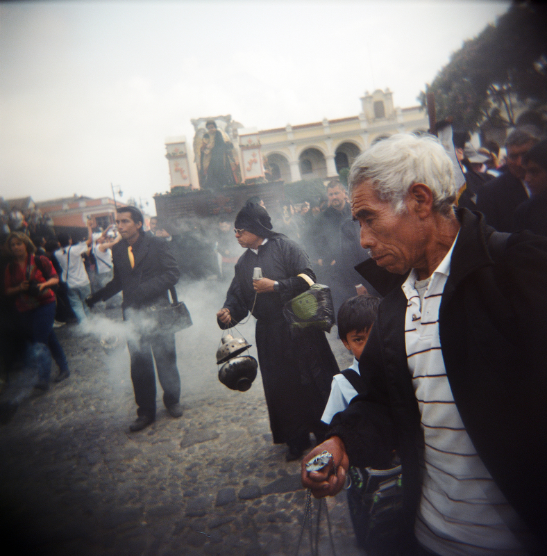 Guatemalans swing incense during a Semana Santa procession in Antigua, Guatemala, April 6, 2012.