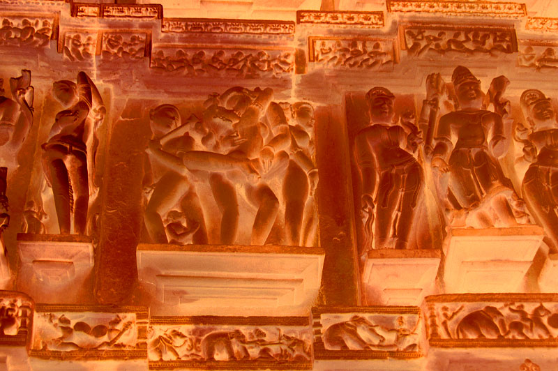 Ilfochrome print - Ed. 3 + 2APMounted face in 0,6 cm (1/4{quote}) Plexiglas101,6 x 152,4 cm (40 x 60{quote})This image was shot in Khajuraho. In the midst of this complex scene, the central couple embraces with extraordinary tenderness. Her arms are flung around him as he holds her. Notice the position of the fingers of his right hand. The small figure at the lower left seems to have a good vantage point from which he can see the intimacy of the action.The lady to the left of the composition stands in a most seductive posture: as she reveals her curvaceous behind, she twists her upper body, enticing the viewer into the scene with her left hand under her breast.This is the epitome of movement in sculpture.