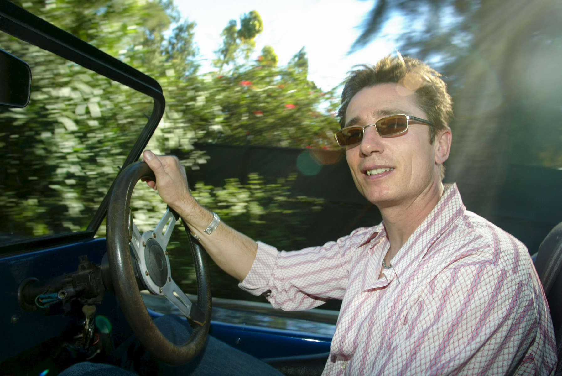 RCK STEWART COOK    REX USA    1 -22-03British actor, Dominic Keating  who plays Lieutenant Malcolm Reed on Star Trek's 5th spin off {quote}Enterprise{quote}. He used to star on Channel 4's comedy Desmond's in the UK. Pictured at his Hollywood Hills home and in his favourite VW kit car under the Hollywood Sign.