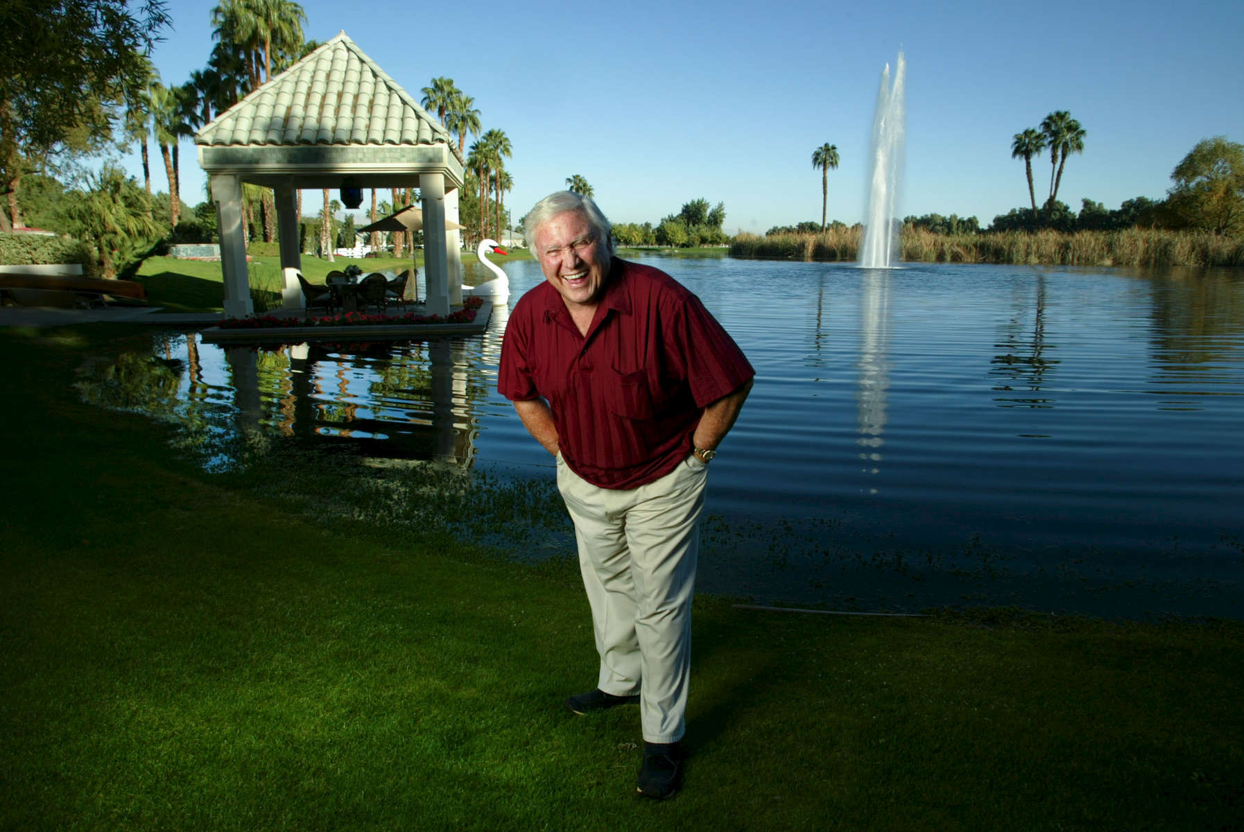 Picture © STEWART COOK   1-30-03  (310) 877 9155Merv Griffin at his Palm Springs ranch complete with lake and stables where he keeps his thorobread racing horses. Pictured with dog Charlie.