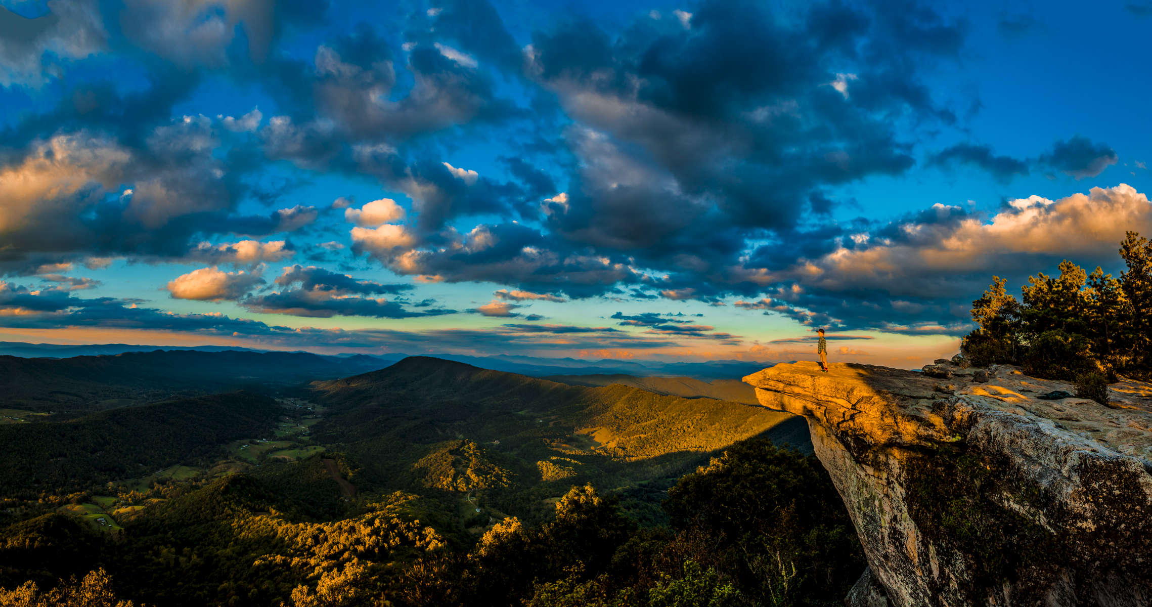 Boy standing on Mcafee Knob on the appalachain trail outside Roanoke, Virginia in the Blue Ridge Mountains.