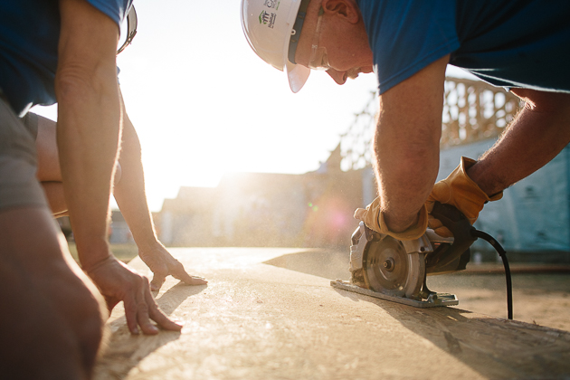 Rick Eby makes a cut early morning, Friday, the last build day for the 2014 Jimmy  and Rosalynn Carter Work Project in Fort Worth.