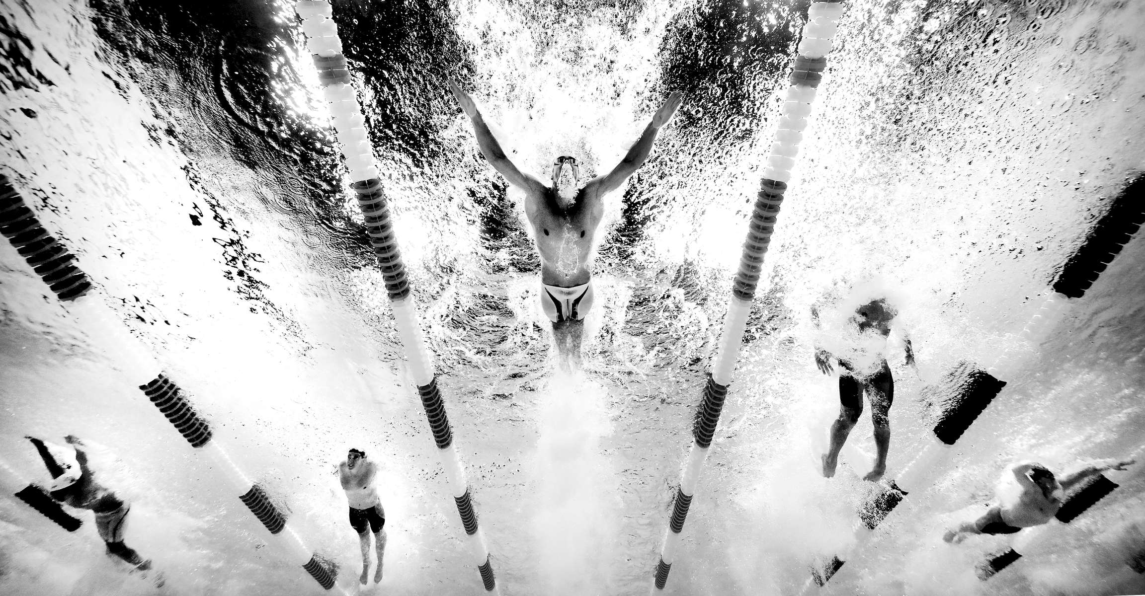 OMAHA, NE - JUNE 29:  (Editors Note: This image has been converted to black and white) Michael Phelps of the United States competes in the final heat for the Men's 200 Meter Butterfly during Day Four of the 2016 U.S. Olympic Team Swimming Trials at CenturyLink Center on June 29, 2016 in Omaha, Nebraska.  (Photo by Tom Pennington/Getty Images)