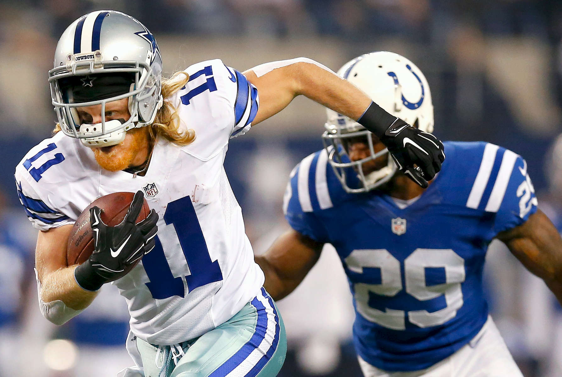 ARLINGTON, TX - DECEMBER 21:  Cole Beasley #11 of the Dallas Cowboys runs for a touchdown after making the catch against the Indianapolis Colts in the first half at AT&T Stadium on December 21, 2014 in Arlington, Texas.  (Photo by Tom Pennington/Getty Images)