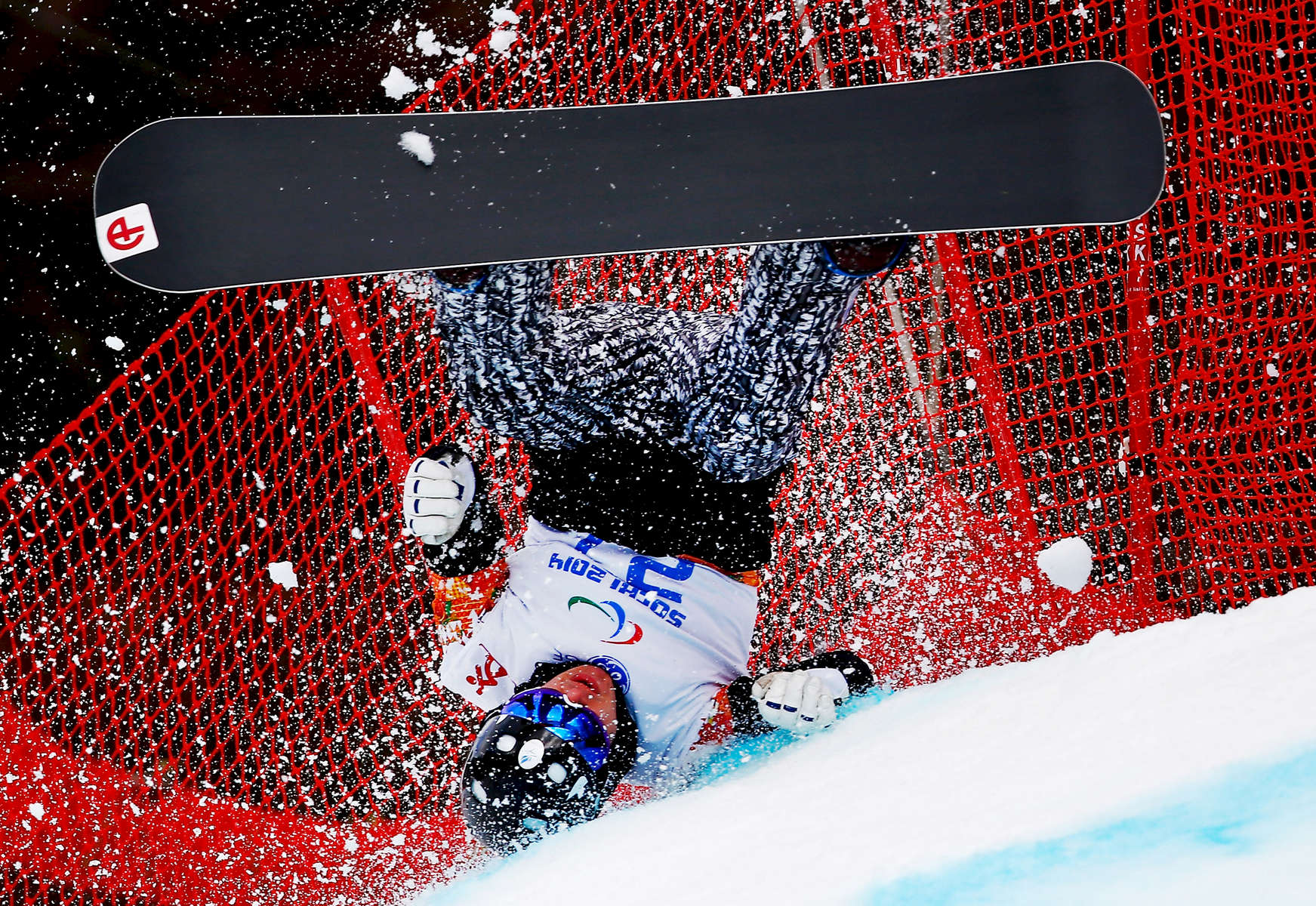 SOCHI, RUSSIA - MARCH 14: Matti Suur-Hamari of Finland crashes during the Men's Para Snowboard Cross Standing on day seven of the Sochi 2014 Paralympic Winter Games at Rosa Khutor Alpine Center on March 14, 2014 in Sochi, Russia.  (Photo by Tom Pennington/Getty Images)