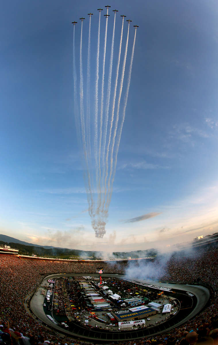 BRISTOL, TN - AUGUST 23:  Team Aerodynamix performs a flyover before the start of the NASCAR Sprint Cup Series Irwin Tools Night Race at Bristol Motor Speedway on August 23, 2014 in Bristol, Tennessee.  (Photo by Tom Pennington/NASCAR via Getty Images)