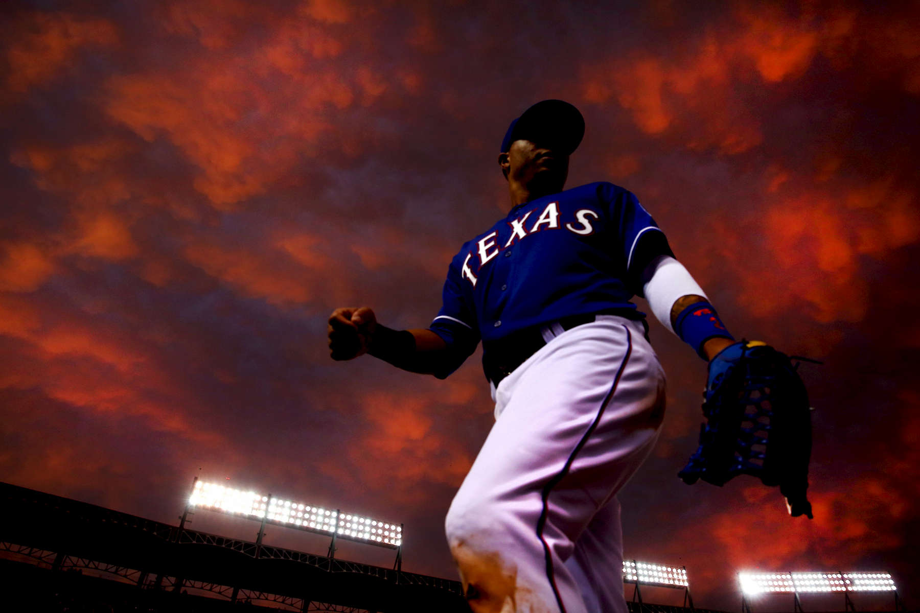ARLINGTON, TX - MAY 08:  Leonys Martin #2 of the Texas Rangers returns to the dugout in the middle of the fourth inning as the Texas Rangers take on the Colorado Rockies at Globe Life Park in Arlington on May 8, 2014 in Arlington, Texas.  (Photo by Tom Pennington/Getty Images)