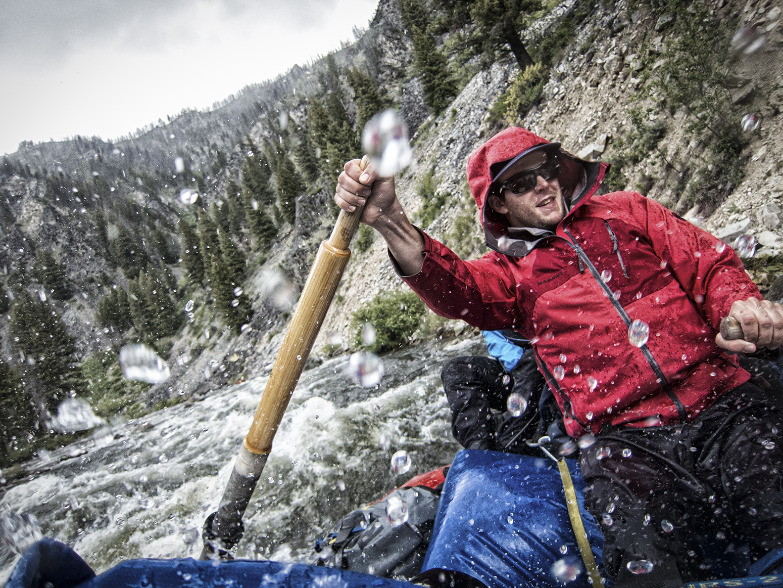 River guide Fritz Horst on a rainy day on the Middle Fork of the Salmon River.