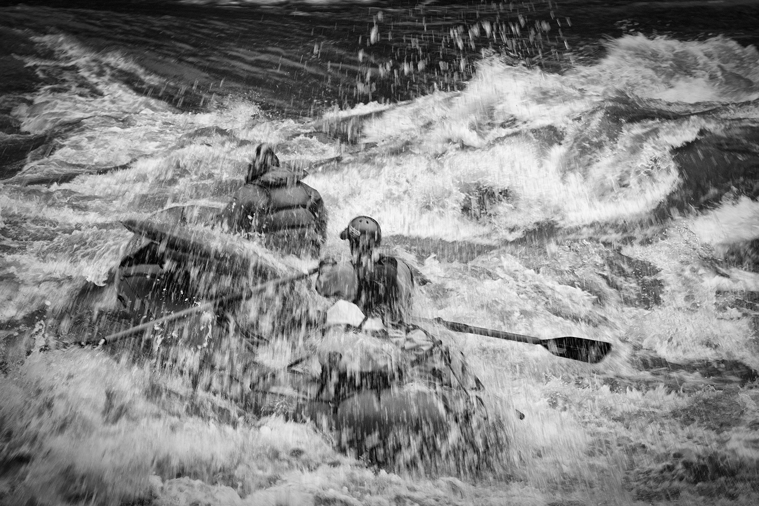 River guide Thomas Batey encountering turbulent water in  Chitham Rapid at 76,000 cfs in spring 2010.