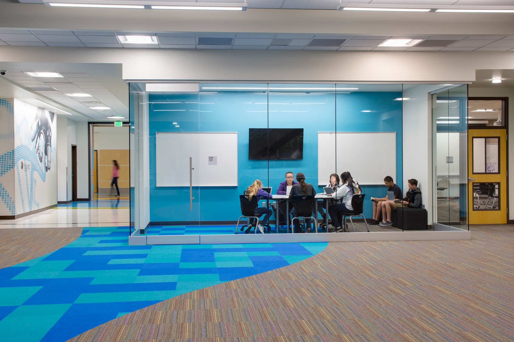 Views of students in private, glass enclosed study rooms at Mt. Jordan Middle School in Sandy Utah for MHTN Architects / Hogan & AssociatesArchitectural Photography by Paul Richer / RICHER IMAGES