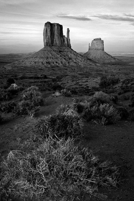 It can be difficult to capture a unique composition of a subject that is photographed frequently.  Arriving very late in the day at Monument Valley, the light was just about to slip away.  I was overwhelmed by the scale of these immense landscape features, which are in fact, several hundred yards away.  Tilting the camera down to capture the shrub in the foreground, my eye is lead up to the mittens.  My hope was to convey the massive scale, (so alien to me) of this great western landscape.