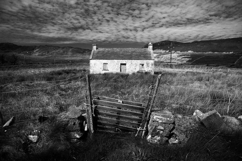 Achill Island, IrelandA cottage sits derelict, complete with an old shipping pallet to keep the sheep from grazing in the front lawn.