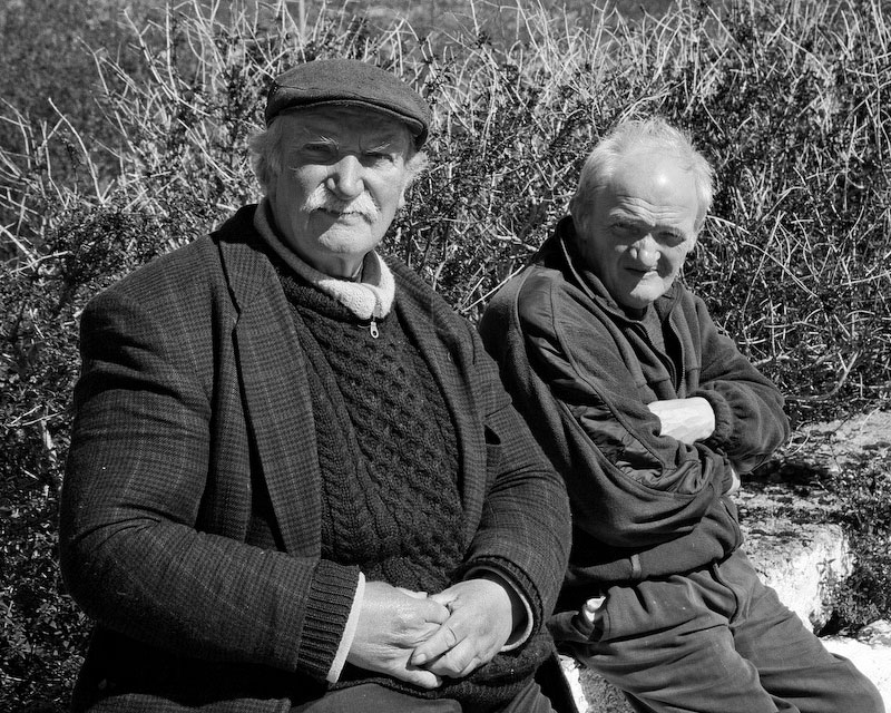 County Mayo, IrelandTwo farmers enjoy a chat on a sunny spring afternoon after a few pints and lunch.