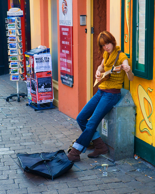 Galway, IrelandA musician begins preparation for an afternoon's performance with the colorful backdrop of downtown Galway behind.