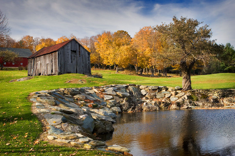 While driving through western Massachusetts on a day-long photo trip in the fall of 2005, I almost passed by this wonderful New England scene; an old shed set atop a small hill just above a pond, flanked by an old apple tree.
