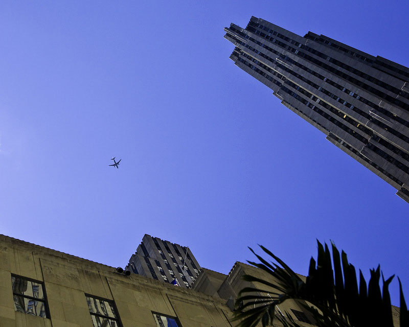 New York CityA plane flies overhead, looking up from 5th avenue.