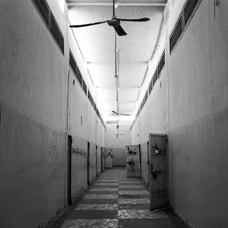 "Abu Salim Prison - July 25th 2012Regarded, as the most atrocious crime carried out by the Gaddafi regime is the mass murder of 1,200 prisoners in Abu Salim prison, which took place over a period of two days in June 1996. Prisoners were led to an outdoor enclosure where they were systematically executed by prison guards standing on the walls above. The cover up of Abu Salim prison lasted more than a decade. Most families didn't receive death certificates until 2002, some as late as 2009, thirteen years after the massacre. To this day the remains of the prisoners of Abu Salim have yet to be found and much of what happened between those two days in 1996 is still unknown. Wedad Ftieta, a widow of the Abu Salim prison massacre states, ""Only after Tripoli fell did I know that he was really dead. I can't believe I have been waiting for my husband who died in 1996. I've lived in hope for such a long time. Ahmed died a martyr for this revolution."" ""The Widows of Abu Salim"" is a document of the women who's husbands were killed in 1996."