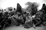 New Somali arrivals gather outside the reception center within Dadaab Refugee Camp. Many arrivals have walked for the past 15 to 30 days to reach the camp.