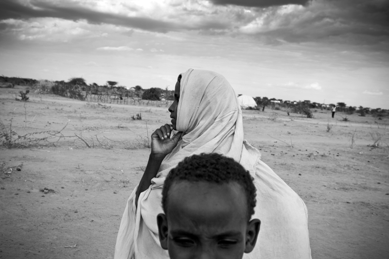 A woman and child in Ifo Extension within Dadaab Refugee Camp. Dadaab is the world's largest refugee camp which is now approaching 500,000 refugees.