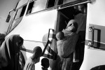 New Somali arrivals are loaded onto a bus at the reception center and driven to the registration center where they are photographed and Id's.