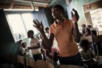"KIBERA SLUM - JULY 11: A 31-year old single woman prays at church with the 9 children who she takes care of in the slum of Kibera in Nairobi, Kenya on July, 11th, 2010. Her brother and his wife died of HIV and her sister died in 2008 after ingesting 25 aspirin to terminate an unwanted pregnancy. Their children now live with her in a single room in Kibera. ""It is very difficult to bring up all these kids alone, work is unpredictable, we usually skip lunch and porridge is our main meal in the evening."" On a good month she can make up to 1,500 Kenya shillings, on a bad month she will only earn 900. Her 17-year-old niece who also lives with her is 6 months pregnant. Her boyfriend left her after learning of the pregnancy. She contemplated an unsafe abortion but her aunt and her pastor urged her to keep the child, as an abortion is life-threatening procedure in Kenya."