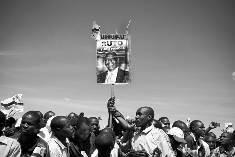 Violence over the disputed presidential race in 2007/2008 left an estimated 1,200 people dead, hundreds of thousands displaced, and four prominent Kenyan leaders facing trial at the International Criminal Court (ICC) on charges of crimes against humanity. Despite those charges, two of the men indicted by the ICC are now running on a joint ticket for president and deputy president. Presidential candidate Uhuru Kenyatta is the son of Kenya's first president and one the richest men in the country; his running mate, William Ruto, a former government minister. Five days after ICC judges confirmed charges against them, Uhuru Kenyatta and William Ruto addressed the crowd. Kenyan's hold a poster in support of William Ruto at a {quote}Peace Rally{quote} in Eldoret, Kenya.