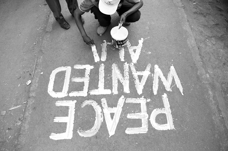 Solo Muyundo, also known as {quote}Solo 7{quote} is an artist living in Kibera. Solo started painting messages around Kibera during the post election violence of 2007/08. Solo 7 paints {quote}Peace Wanted Alive{quote} in Kibera on March 4th, 2013 in the slum of Kibera in Nairobi, Kenya.