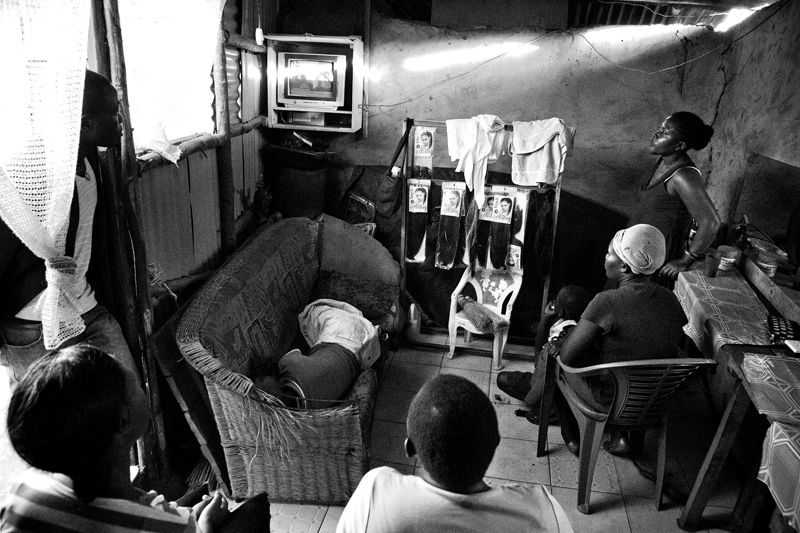 Kenyans watched election results on television at a beauty shop in the slum of Kibera.