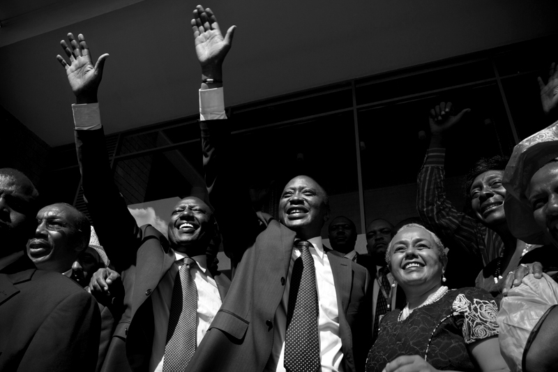 President elect Uhuru Kenyatta (right) with his running mate, Vice President Elect William Ruto (Left) celebrate the announcement that they had won the presidential race in Kenya. Kenyatta and Ruto wave to a crowd of TNA supporters at Jubilee Media center. The Independent Electoral and Boundaries Commission ( IEBC) chair Isaac Hassan declared Uhuru Kenyatta duly elected President of Kenya after he garnered 50.07 per cent of votes cast.