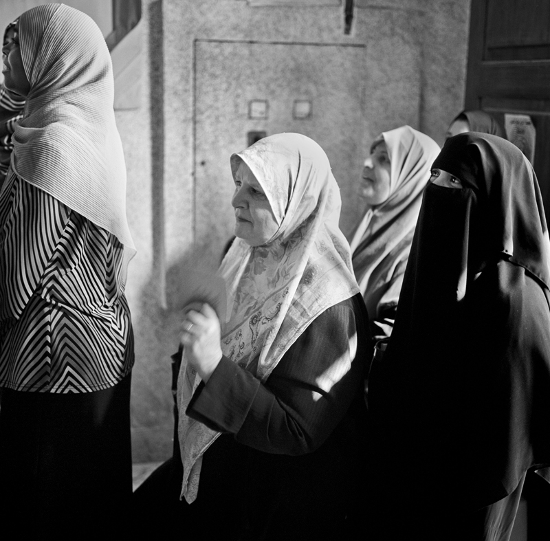 Women from all walks of life line up to vote in Libya's historical Parliamentary Election following their revolution.
