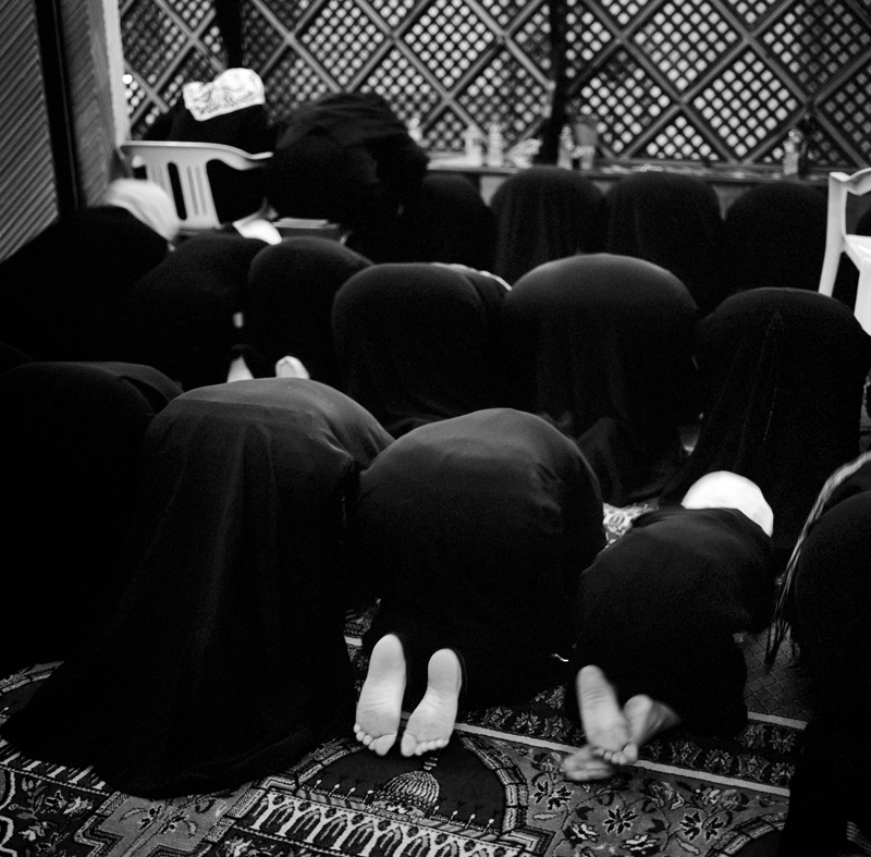 Women and children pray at Isha prayer at a Mosque in Tripoli during the holy month of Ramadan.