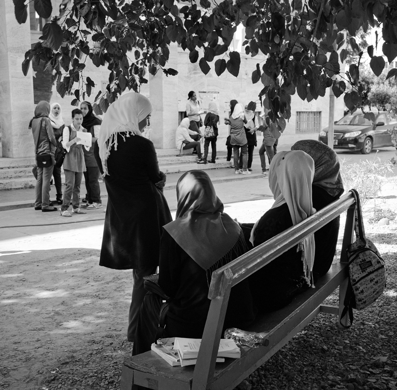 Libyan girls wait outside of their school for their final exams to begin. {quote}The biggest hardship is convincing people we're qualified. Generally most people think women are less qualified than men. This is most people. Even though women usually have higher scores and degrees than men. It's not only qualification, it's trust on how much we'll give to our work; how much time we'll put in. People consider women a waste of time. She may work for a year or two, but once she's married and has a child she'll become lazy in the work place or leave all together. Employers think it's not worth their time training a woman because she wont be around for a long period. This is not true. Women are so dedicated, to job and to home; this is two jobs.{quote} -Nehad Abu El-Komsan, Chairwoman of the Egyptian Center for Women's Rights