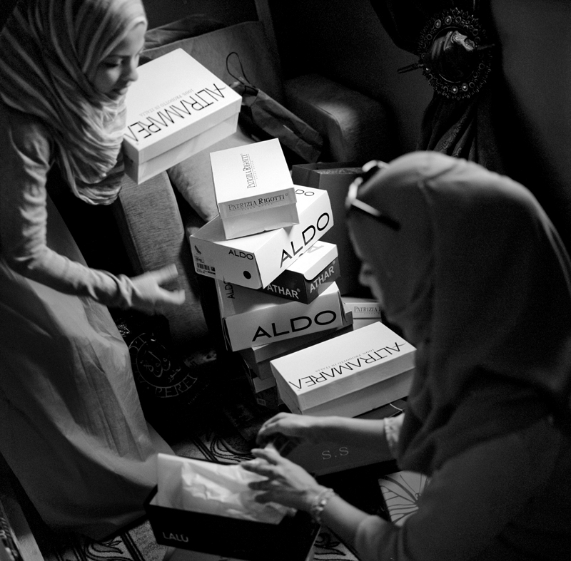 Nour helps her older sister organize her new wardrobe. When Libyan women become engaged, they start the process of buying new clothes for their new life with their husband. Depending on the wealth of the family, thousands and thousands of Libyan dinars are spent on the new apparel.