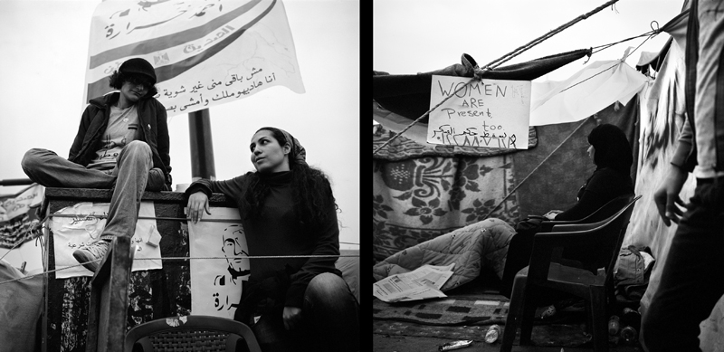 "Left: Jasmine Hamdoun, 32 and Reem El Adl, 29 spend their day at work and come to Tahrir Square around 4pm everyday. They have a tent in the square and sleep there every night. ""We stay here and wait for other people to take part in marches."" They explain they will stay in the square until ""the military rule is brought down and there are no military trials for civilians. We are facing more violence now than before; this has to stop. We are calling for a civilian presidential council that will resolve the country. The military must resign because of too much aggression. I think they are using poison gas on us and that many people will leave Tahrir with cancer.""Right: In Tahrir Square, a sign hangs, {quote}Women Are Present Too.{quote} On March 8th, 2011, widely recognized as International Women's Day, Egyptian women peacefully demonstrated in Tahrir Square. The Coalition of Egyptian Feminist Organizations states ""The participants then stood on the pavement, and got involved in a constructive dialogue about issues of citizenship, discrimination and social justice."" Shortly thereafter, participating women were barraged with physical assault, sexual harassment and verbal abuse by a group of men. Women were chased through the square, sexually assaulted and in some cases beaten. Women have been largely barred from all discussions on democracy in Egypt."