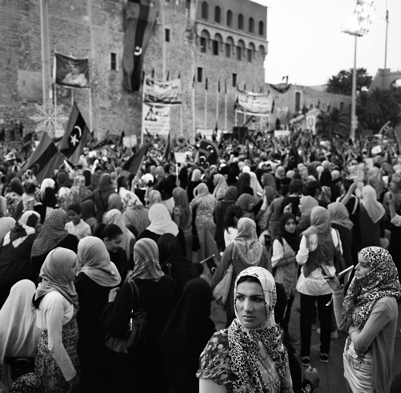 Women gathered by the thousands in Tripoli's Martyrs' Square (formerly known as Green Square) to celebrate the ousting of Muammar Gaddafi. A sea of head scarves, national flags and victory signs filled the square where women sang songs and chanted in celebration. Women for the most part have been out of the public eye during the revolution, but many have been working behind the scenes to liberate the country from the 42 year oppressive regime.