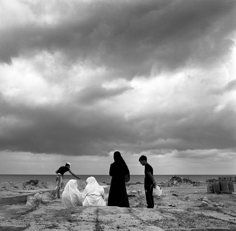 Eyadea Elspaie, 50, visits the grave of her son at Ali Hensheri Cemetery, which is named after on old martyr. Tarea Elspaie, 34 was killed by African mercenaries on August 27th in El Hadba.