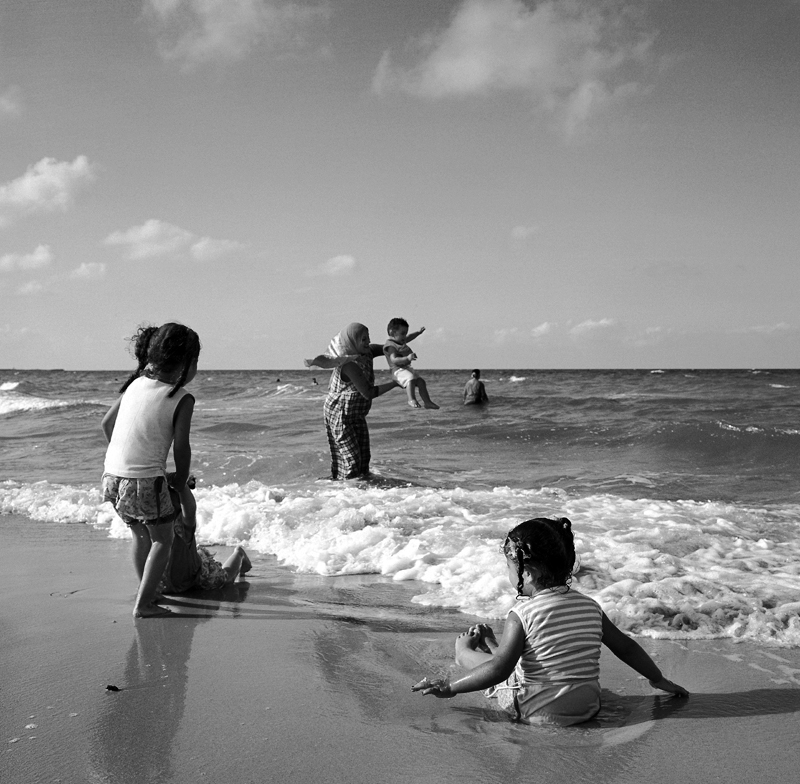 As Tripoli slowly returns to normal, woman and children begin to venture out of the house, where many have been in hidding since mid February. A family spends a day at the beach in Tajoura in a new and free Libya.