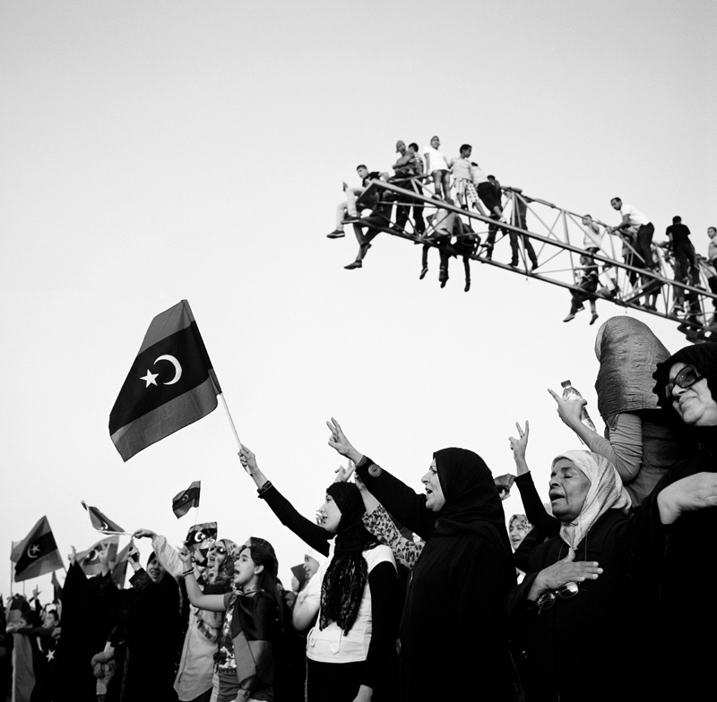 Women gathered by the thousands in Tripoli's Martyrs' Square (formerly known as Green Square) to celebrate the ousting of Muammar Gaddafi. A sea of headscarves, national flags and victory signs filled the square where women sang songs and chanted in celebration. Women for the most part have been out of the public eye during the revolution, but many have been working behind the scenes to liberate the country from the 42-year oppressive regime.