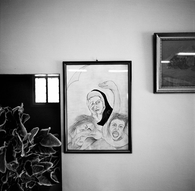A drawing hangs on the wall in the {quote}grains of hope{quote} office in Misrata. The group is comprised predominantly of women who make food for the rebels on the front line, approximately 300 meals a day. In addition, they also collect money and clothes for families whose houses were destroyed during the intense fighting in Misrata. The drawing, created by group member Fatima El Jamal, tells the story of women raped in Misrata. A Libya National Flag now officially adopted by The National Transitional Council is draped over one of the women depicted to symbolize protection.
