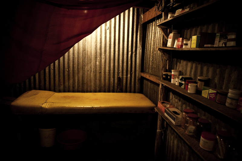 KIBERA SLUM – JULY 19: A chemist and an illegal abortion doctor's clinic, which has been in operation in Kibera since 1999. He says that poverty is the main cause of abortion. Women come to him with an unwanted pregnancy and he provides them with ergometrine and oxytocin to induce their pregnancy. He will charge 2,000 to 4,000 Kenya shillings for these pills, which include a check up after the termination is complete. Most women take the pills at their homes in Kibera when they are alone and expel the fetus by themselves without the help of a physician or nurse.