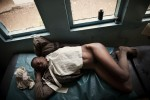 KISUMU – JULY 4: A 24 year old Kenyan woman relaxes on a bed in Kisumu District Hospital after a speculum exam shows that she is suffering from septic abortion in Kenya on July 4th, 2010. Septic abortion whether spontaneous or induced is the termination of a pregnancy in which the mother's life may be threatened because of infection and germs. The woman requires immediate care, antibiotics and possibly evacuation of the uterus.