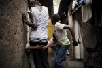 "KIBERA SLUM - JULY 11: Children play in the alley way outside their home in the slum of Kibera in Nairobi, Kenya on July, 11th, 2010. Their aunt, a 31-year old single woman takes care of the 9 children. Her brother and his wife died of HIV and her sister died in 2008 after ingesting 25 aspirin to terminate an unwanted pregnancy. Their children now live with her in a single room in Kibera. ""It is very difficult to bring up all these kids alone, work is unpredictable, we usually skip lunch and porridge is our main meal in the evening."" On a good month she can make up to 1,500 Kenya shillings, on a bad month she will only earn 900. Her 17-year-old niece who also lives with her is 6 months pregnant. Her boyfriend left her after learning of the pregnancy. She contemplated an unsafe abortion but her aunt and her pastor urged her to keep the child, as an abortion is life-threatening procedure in Kenya."