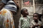"KIBERA SLUM - JULY 11: A 31-year old single woman takes care of 9 children who are her nieces and nephews in the slum of Kibera in Nairobi, Kenya on July, 11th, 2010. Her brother and his wife died of HIV and her sister died in 2008 after ingesting 25 aspirin to terminate an unwanted pregnancy. Their children now live with her in a single room in Kibera. ""It is very difficult to bring up all these kids alone, work is unpredictable, we usually skip lunch and porridge is our main meal in the evening."" On a good month she can make up to 1,500 Kenya shillings, on a bad month she will only earn 900. Her 17-year-old niece who also lives with her is 6 months pregnant (pictured). Her boyfriend left her after learning of the pregnancy. She contemplated an unsafe abortion but her aunt and her pastor urged her to keep the child, as an abortion is life-threatening procedure in Kenya."