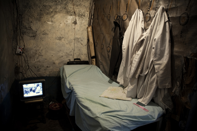 KIBERA SLUM - JULY 29: A surgery theater carefully hidden behind a chemist in the slum of Kibera on July 29th, 2010 in Nairobi, Kenya. The doctor who preforms illegal abortions in this makeshift clinic is not a trained professional, and was taught the MVA (manual vacuum aspiration) method by a friend. The environment is not sterile, which increases the health risk of the patient.