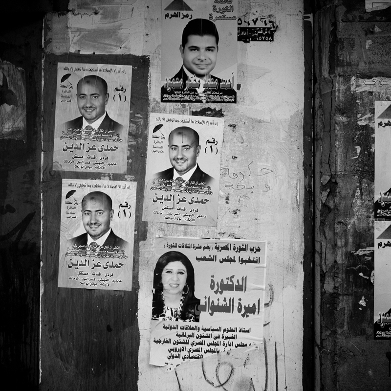 Posters of candidates running for Parliamentary elections cover the walls through out the capitol of Cairo. Women in Egypt were given the right to vote in 1956 and turned out in surprisingly high numbers to vote in Egypt's historic parliamentary elections. 1979 was the first year that a women's quota of seats in parliament was first implemented, which has now been abolished under the new electoral law. Under the Egyptian election laws, political groups are required to include at least one female candidate but fail to specify where their names should be included on the voting ballot. Many women's names were placed at the bottom of the ballot, reducing their chances of being elected to a seat.