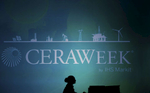 An employee is silhouetted at CERAWEEK in Houston