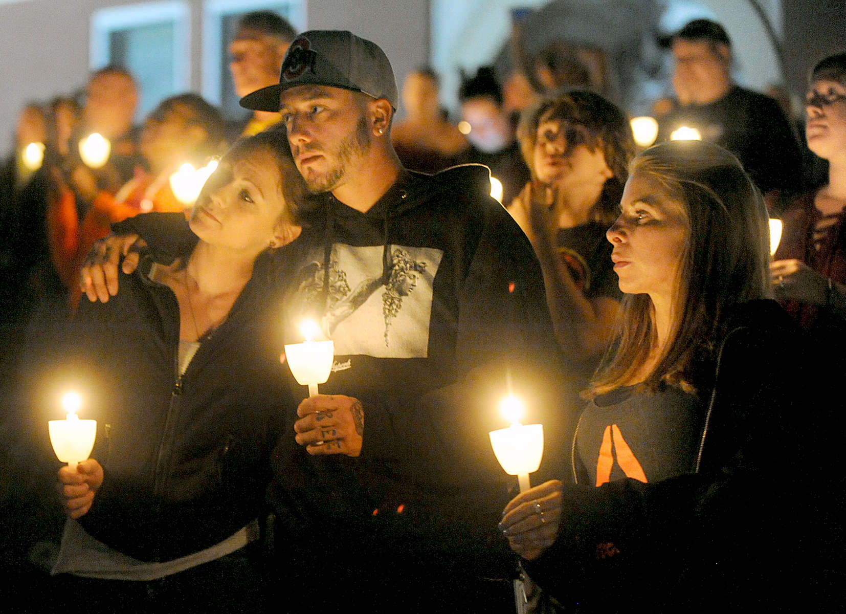 8/31/17-- MARLBOROUGH-- At the candlelight vigil for Opiod Awareness Day in front of the Walker Building Thursday night, from left: Shawna Simpson of Marlborough; Adam Schofield, of Marlborough; and Karen Cannistraro, of Hudson. [Daily News and Wicked Local Staff Photo/Art Illman]